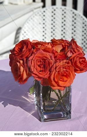Red Rose Grand In The Transparent Glass Vase As A Decoration Of Wedding Table