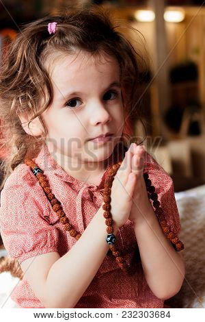Little Kid Girl Making Namaste Sing By Hands