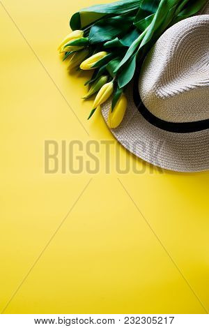 Hat And Yellow Tulips Over Yellow Background, Copy Space