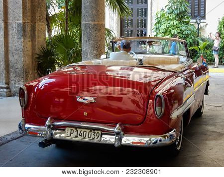 Havana, Cuba, 05.16.2016: A Flaming Vintage Car Waiting In Front Of The National Hotel.