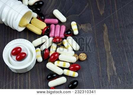 Open Prescription Bottles And White And Yellow Tablets, Pills, Vitamins, Medicine, Pilule And Drugs