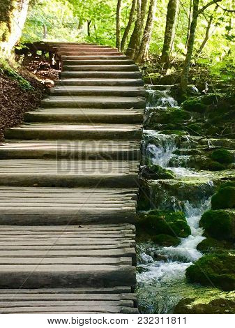 Walk On Wooden Alley With Cascades In A National Park Of Croatia.