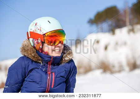 Image Of Female Athlete In Mask And Helmet On Blurred Snowy Day Background