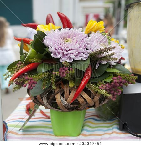 Bouquet Of Chrysanthemums, Pepper, Spruce And Birch Bark On The Tablecloth In Striped