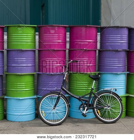 The Bicycle Near Plenty Of Colour Barrels