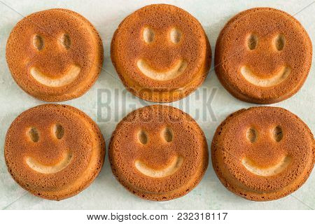 Funny Cupcakes In Form Of Smiling Face. Food That Causes Positive Emotions. Humorous Sweet Food. Goo
