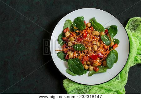 Vitamin Vegetarian Salad With Chickpea, Carrot, Sweet Pepper And Spinach. Dressed With Vinaigrette S