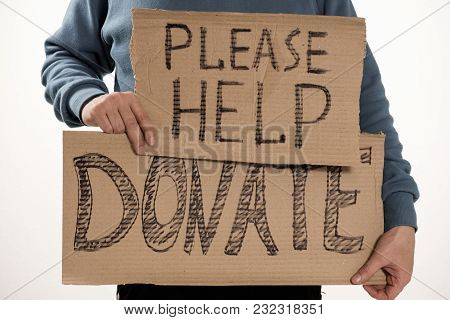 Homeless Poor Man Holding Carton Board With Word Food Donate For Donations