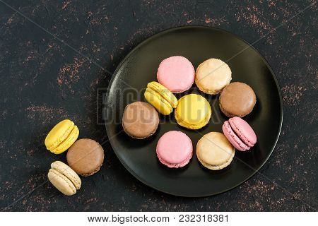 Different Macaroon On Black Plate On Dark Background. Delicious And Sweet Almond Cookies Macaroon Wi