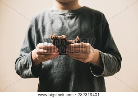 Child Beggar Eating Cheap Dirty Bread. Poor Children And People Donations Volunteers Concept.
