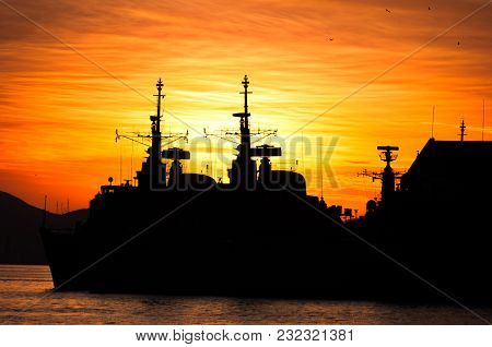 Two Military Navy Ships Silhouettes By Sunset