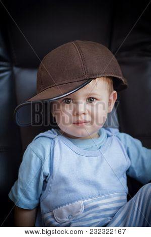 Portrait Of A Little Boy In A Cap