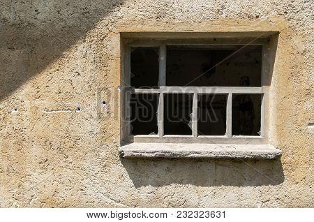 Broken Window On An Abandoned Chicken Farm