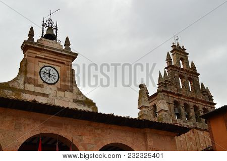 Bell Tower And Town Hall Clock In Ayllon Cradle Of The Red Villages Of Segovia. Architecture Landsca