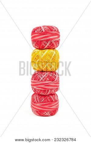 Four Sewing Threads On White Background. Red And Yellow Thread