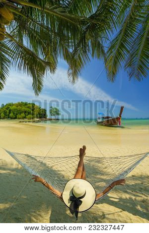 Woman on a hammock at the beach