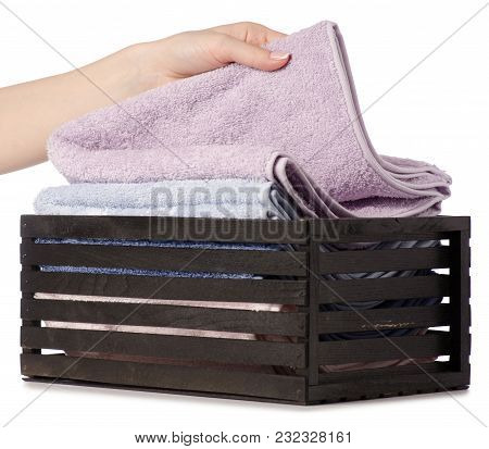 Towels Color Set In A Box Bath In Hand On A White Background Isolation