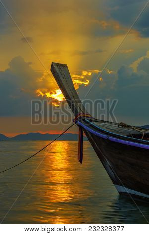 Traditional long-tail boat on the beach in Thailand