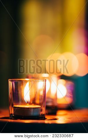 Candles In Spa Zone With Beautiful Relaxing Liight And Dlurry Colorful Backdrop.