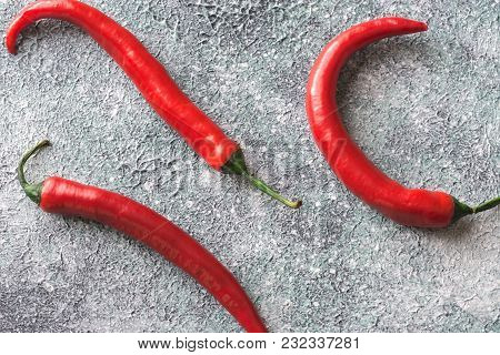 Fresh Chili Peppers On The Gray Background