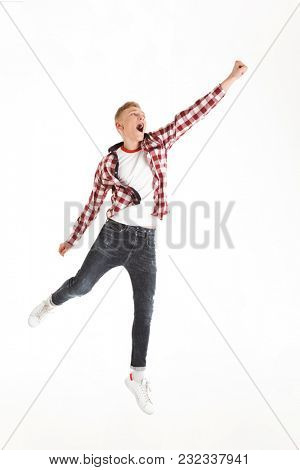 Full length picture of content youngster 18y wearing plaid shirt yelling and acting like superhero lifting hand upward isolated over white background