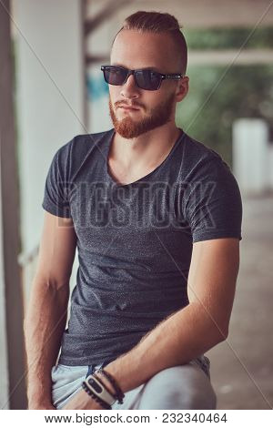 Handsome Redhead Male With A Stylish Haircut And Beard Dressed In Sportswear With A Bicycle Standing