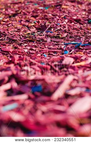 Textured Background Decorative Colored Sawdust For Finishing Flowerbeds In The Winter Season. Red An