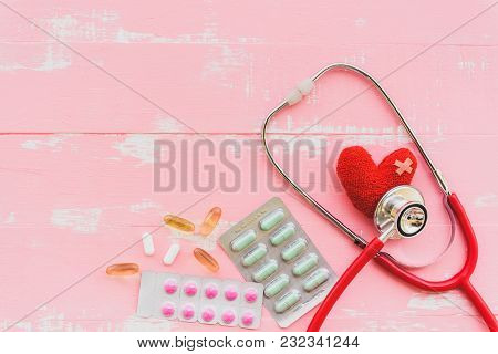 World Health Day, Healthcare And Medical Concept. Red Heart With Stethoscope And Yellow Pill On Past