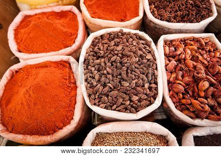 Closeup Of Bags With Colored Spices On The Market In Goa, India
