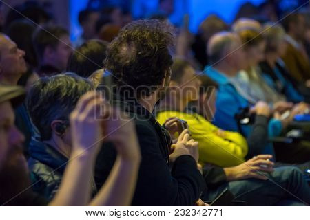 Audience listens to the lecturer at the conference hall