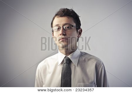 Young businessman with snobbish expression