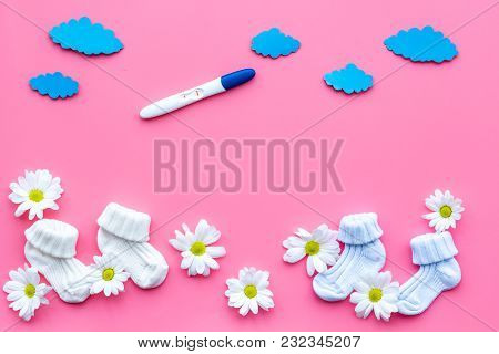 Pregnancy Test, Socks And Flowers On Pink Background Top View Mock Up