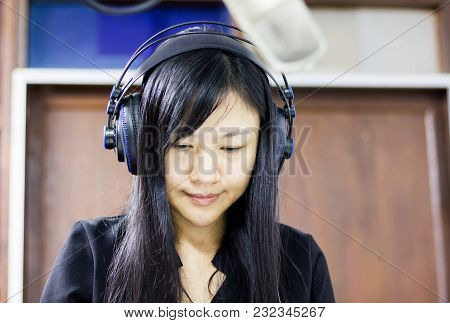 Long Hair Asian Women Wearing Headphone With Foreground Microphone