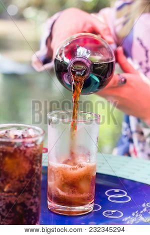 Puring Big Bottle Soda To Glass In Summer Mood, Black Soda Sweet Beverage