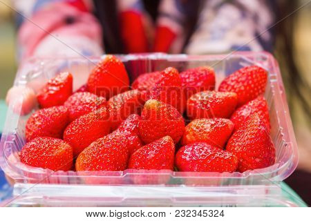 Group Of Strawberry In Plastic Box Packaging With Blur Hand