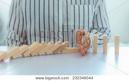 Businesswoman Action Hand Stopping Dominoes Effect., Business Concept