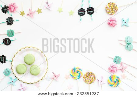 Sweets For Party Background. Macarons And Lollipop On White Top View.