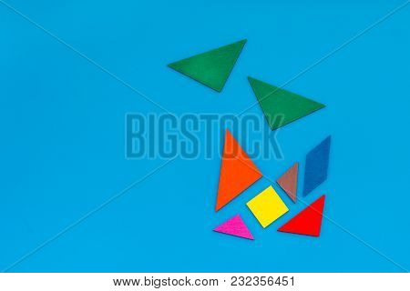 Pieces Of Bright Paper For Puzzle On Blue Office Desk Background Top View Mockup