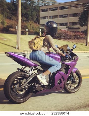 Women Riding Purple Motorcycle On Street With Black Helmet