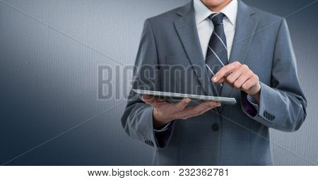 Digital composite of Business man mid section with tablet against navy background