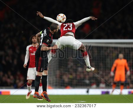 Leonardo Bonucci of AC Milan and Danny Welbeck of Arsenal compete for the ball during the Europa League match between Arsenal and AC Milan at The Emirates Stadium on March 15, 2018 in London, UK