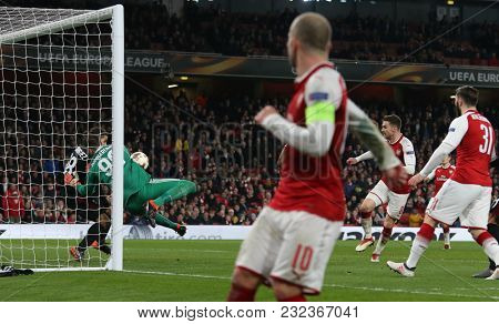 Gianluigi Donnarumma of AC Milan makes a save of Aaron Ramsey of Arsenal during the Europa League match between Arsenal and AC Milan at The Emirates Stadium on March 15, 2018 in London, United Kingdom