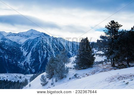 Beautiful View Of The Tops Of The Snow-capped Mountains. Winter Landscape In The Mountains.