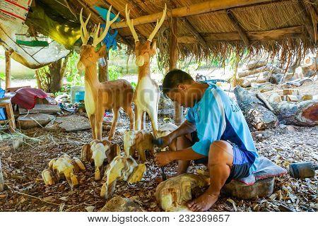 Lampang, Thailand - November 3, 2012: Craftsman Craving A Piece Of Wood To Make Deer Sculpture For F