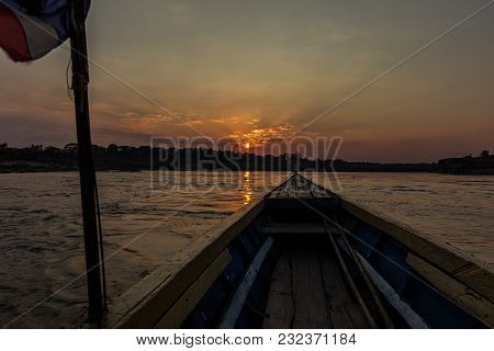 Front View Of Old Fishing Boat With Thailand Flag Golden Sunset As A Background
