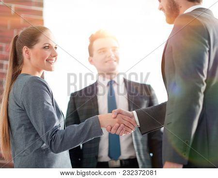 business concept .handshake financial partners.