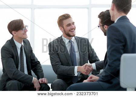 handshake business people in the office.