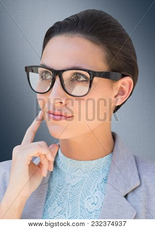 Digital composite of Close up of business woman with glasses thinking against navy background