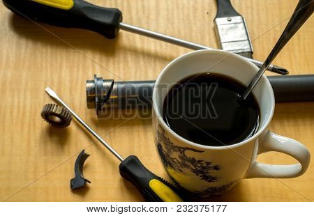 Printer Parts, Tools, Grease, Broken Gear And Coffee Mug On The Table
