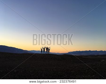 Kids Jumping In The Sunset Light In Death Valley National Park